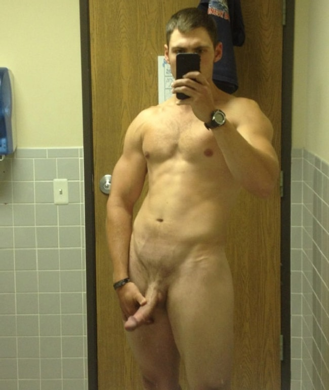 Hunk Holding Cock